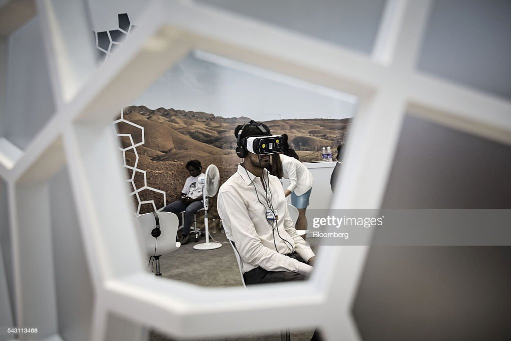 A participant wears a virtual reality (VR) headset at the World Economic Forum (WEF) Annual Meeting of the New Champions in Tianjin, China, on Sunday, June 26, 2016. The meeting runs through June 28. Photographer: Qilai Shen/Bloomberg via Getty Images