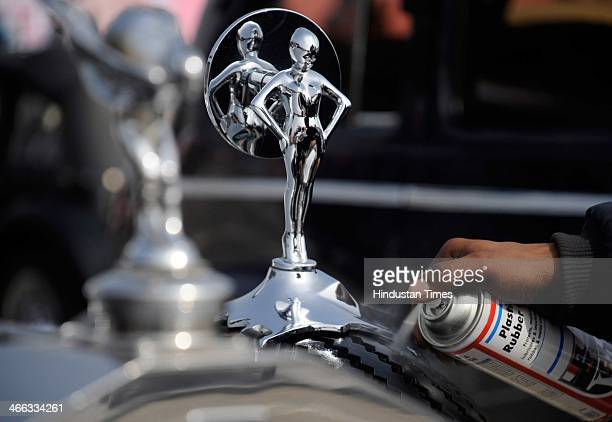 A participant wipes his 1932 Rolls Royce during the 21 Gun Salute International Vintage car rally and auto show on February 1 2014 in Gurgaon India...