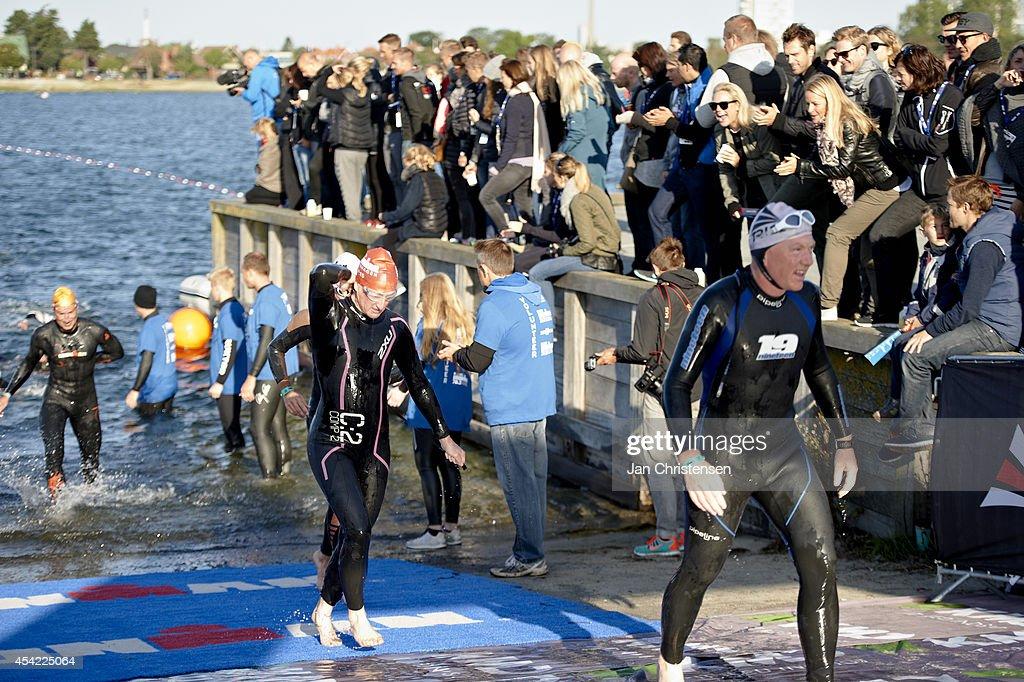 Participants after swimming during KMD Ironman Copenhagen on August 24, 2014 in Copenhagen, Denmark.