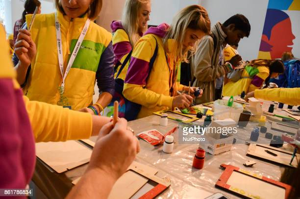 Participants are painting different kind of art during the Grand Opening Ceremony of 19th World Festival of Youth and Students in Bolshoy Sports...