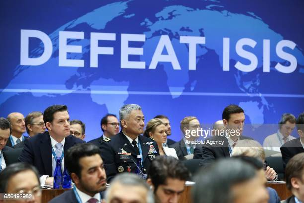 Participants are seen as the US Secretary of State Rex Tillerson makes an opening speech during the Ministers of the global coalition on the defeat...