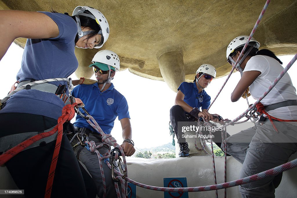 Participants are strap with safety harness as they prepare to abseil down at the Merlion at Sentosa during the OBS-The Merlion Charity Abseil on July 20, 2013 in Singapore. Abseiling The Merlion at Sentosa, an iconic national structure that stands at a formidable height of 37m, calls on donors to draw not just monetary contributions but also courage in literally stepping out of their comfort zone. All proceeds go to Life Community Services Society, a registered charity that takes care of disadvantaged children and at-risk youth from low income families and whose parents are incarcerated.