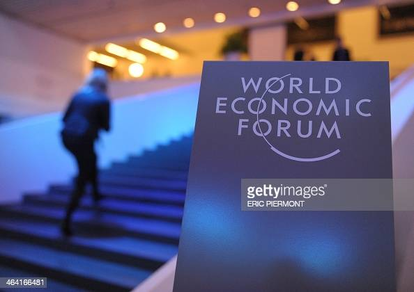 Participants arrive at the congress centrre prior to the opening of the World Economic Forum in Davos on January 21 2014 Some 40 world leaders gather...