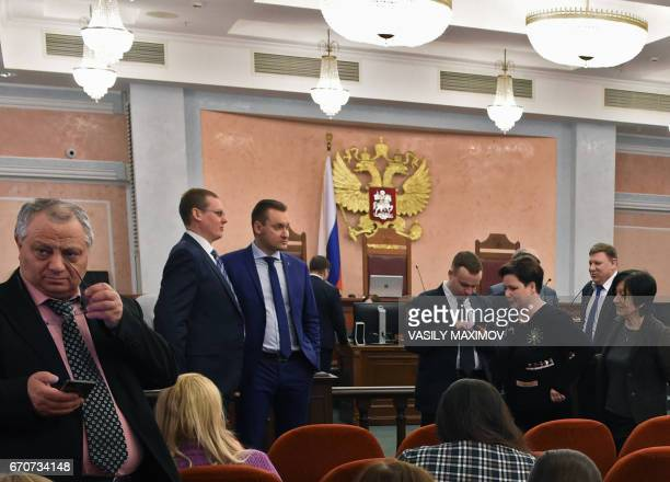 Participants attend a hearing on the justice ministry request to ban the Jehovah's Witnesses at Russia's Supreme Court in Moscow on April 20 2017...