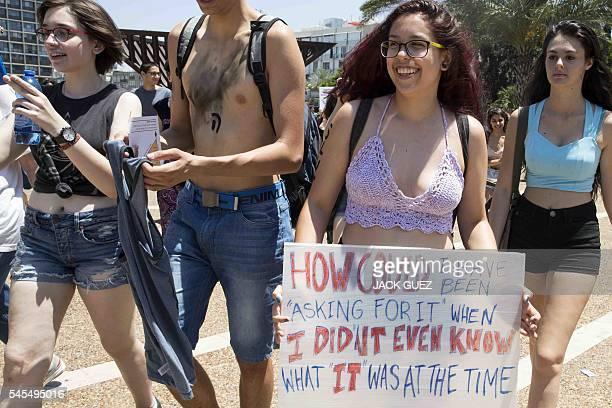 Participants attend the annual 'SlutWalk' in the Israeli Mediterranean coastal city of Tel Aviv on July 08 2016 to protest against rape culture...