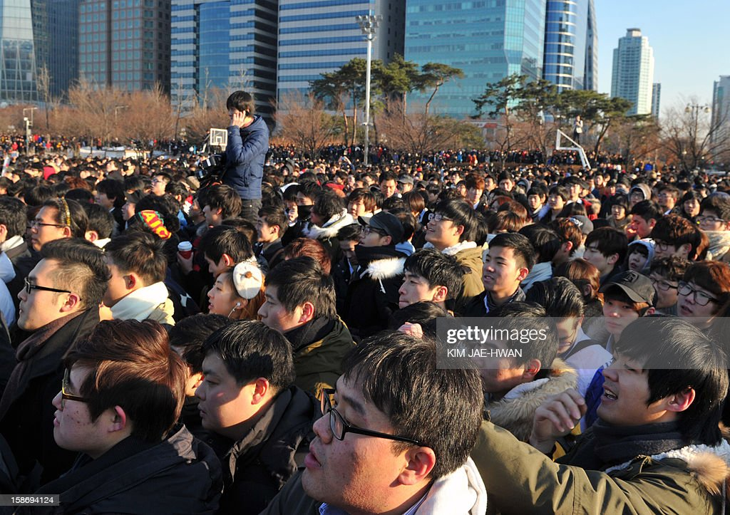 Participants attend the 'battle of the singles,' a mass dating event organised on social networking site Facebook, at Yeouido park in central park in Seoul on December 24, 2012. Thousands of lovelorn South Korean men have flooded the 'battle of the singles' on Christmas Eve, a mass dating event triggered by an innocuous query posted on Facebook -- only to meet other guys.