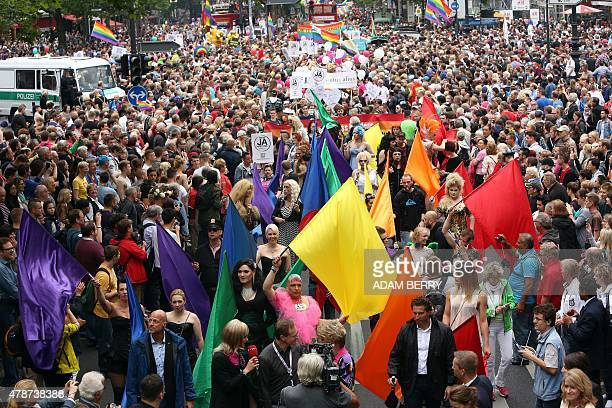 Participants attend the Christopher Street Day gay parade in Berlin on June 27 2015 AFP PHOTO / ADAM BERRY