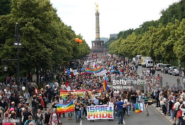 Participants attend the Christopher Street Day gay parade in front of the Siegesaeule or Victory Column in Berlin on June 27 2015 AFP PHOTO / ADAM...