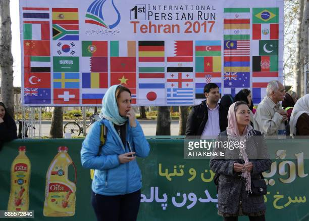 Participants attend the first international Tehran marathon at Azadi Square in the Iranian capital on April 7 2017 Americans are among runners from...