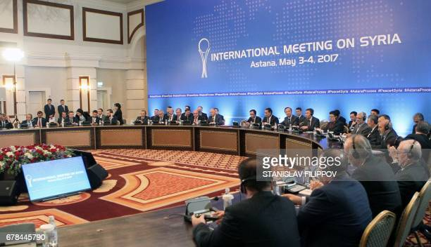 CORRECTION Participants attend the fourth round of Syria peace talks in Astana on May 4 2017 / AFP PHOTO / STANISLAV FILIPPOV / The erroneous...