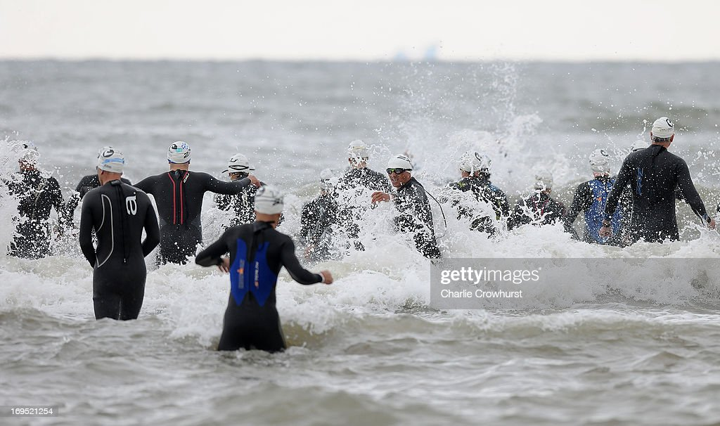 Participants begin the swim during the Challenge Family Triathlon Rimini on May 26, 2013 in Rimini, Italy.