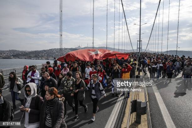 Participants carry a big Turkish flag during Vodafone 39th Istanbul Marathon at The 15 July Martyrs Bridge in Istanbul Turkey on November 12 2017 It...