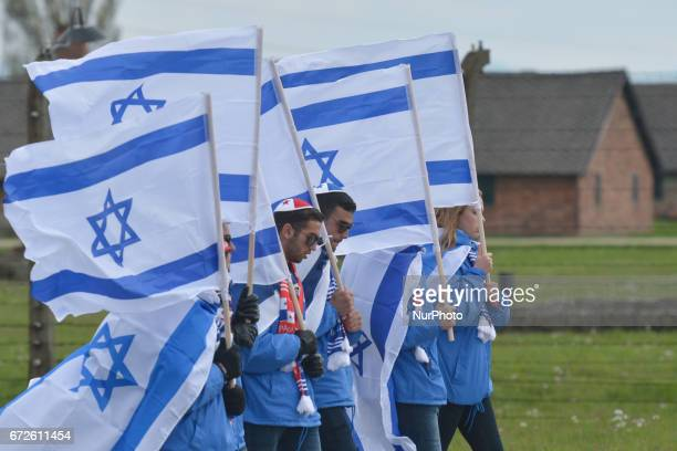 Participants carrying Israeli flags walk during the annual March of the Living Jewish people from Israel and around the world marched the 3km route...
