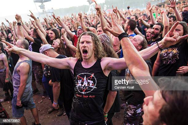 Participants celebrate the concert at the 2015 Woodstock Festival Poland on August 1 2015 in Kostrzyn Poland The Polish Woodstock music festival also...
