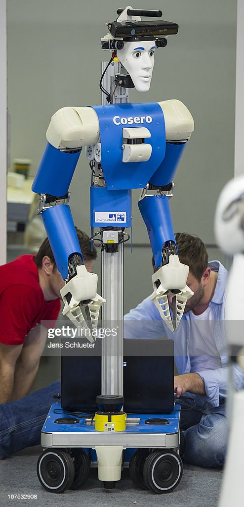 Participants check a service robot at the 2013 RoboCup German Open tournament on April 26, 2013 in Magdeburg, Germany. The three-day tournament is hosting 43 international teams and 158 German junior teams that compete in a variety of disciplines, including soccer, rescue and dance.