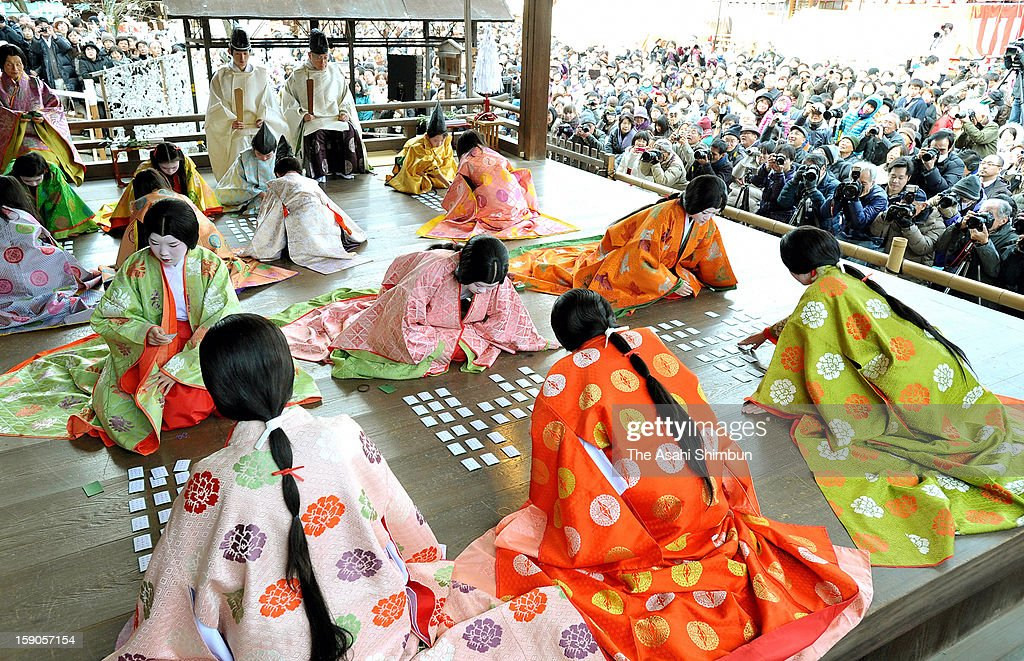 Participants clad Heian Period (794-1185) court costumes play the first ' Karuta' card game of new year at Yasaka Shrine on January 3, 2013 in Kyoto, Japan. The participants, aged between 8 and 25, competed to find the cards containing the second half of the Hyakunin-isshu poems being read aloud.