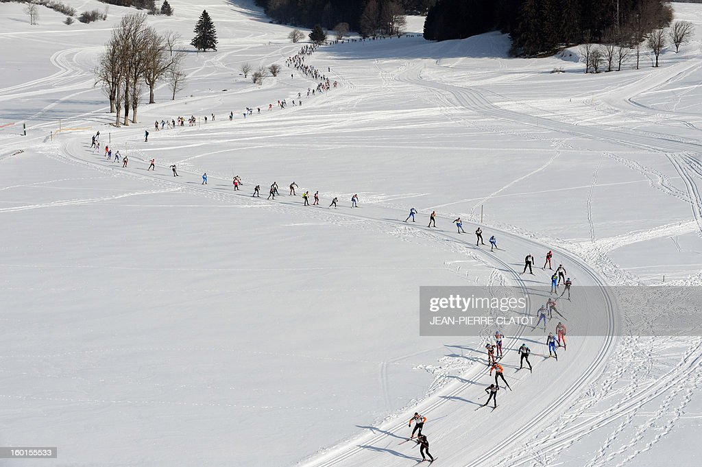 Participants compete during the 35th 'Foulee blanche' (White stride) 42km cross country skiing race on January 27, 2013 in Autrans, French Alps. French skier Adrien Mougel won the event ahead of his compatriots Yvan Pérrillat Boitteux and Benoit Chauvet.