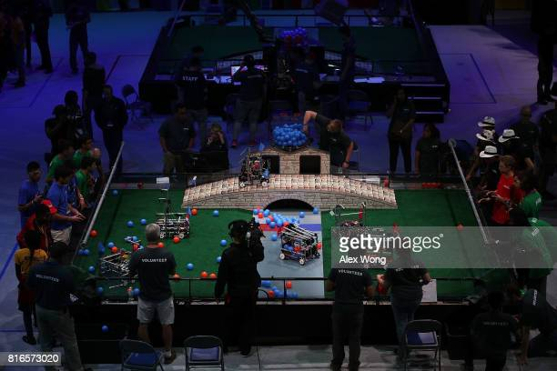 Participants compete during the first of two days of the First Global International Robot Olympics an international robotic challenge July 17 2017 at...