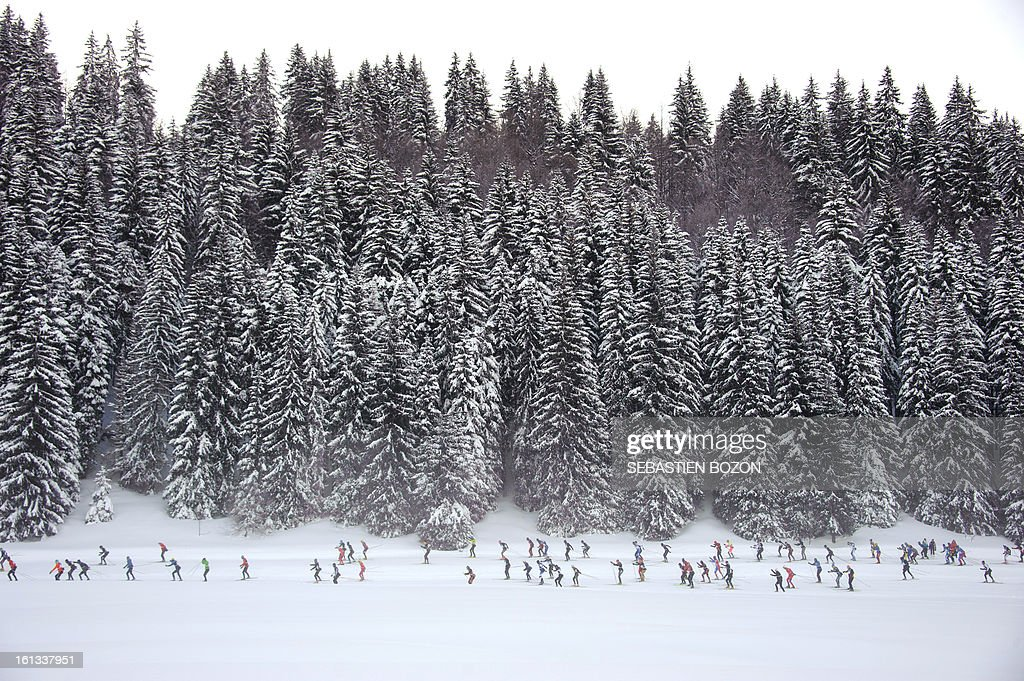 Participants compete during the Nordic Transjurassienne skiing race on February 10, 2013 in Lamoura, eastern France.