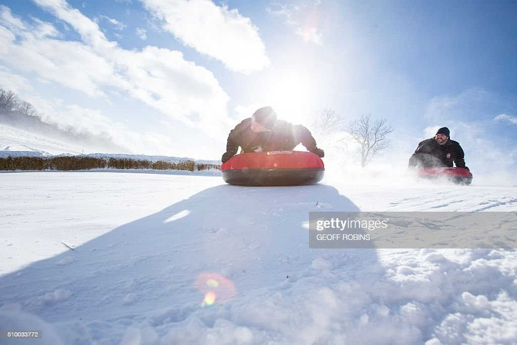 Participants compete in the 1st World Tubing Championship in St. Thomas, Ontario, on February 13, 2016. The inaugural event is a fundraiser for the Special Care Nursery at St. Thomas Elgin General Hospital attracted nearly 50 teams. / AFP / Geoff Robins