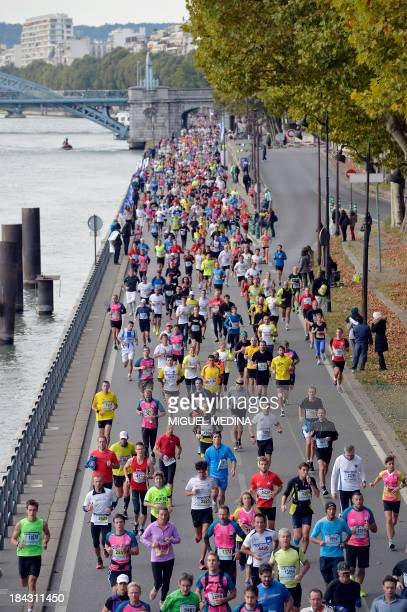 Participants compete in the 35th edition of the 20 kilometres of Paris on October 13 2013 AFP PHOTO/MIGUEL MEDINA