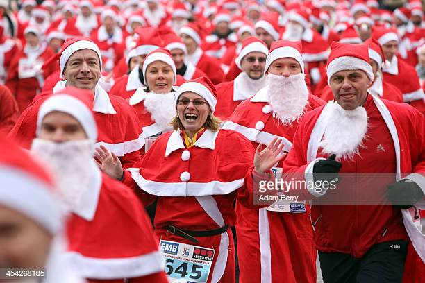 Participants compete in the 5th annual Michendorf Santa Run on December 8 2013 in Michendorf Germany Over 900 people took part in this year's races...