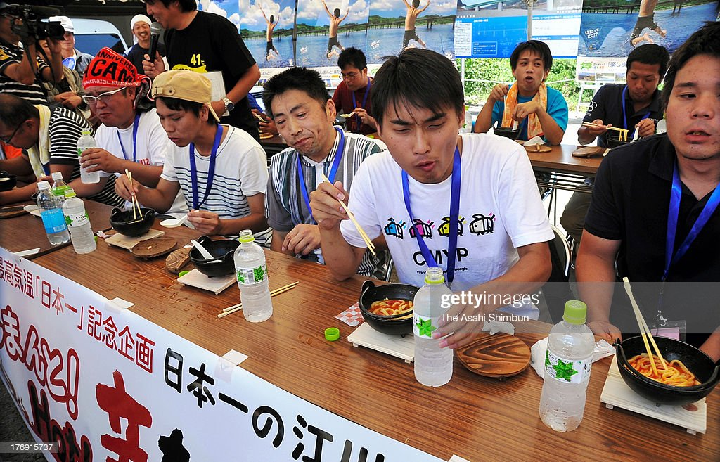 Participants compete in the Hot chilli udon noodle contest on August 18, 2013 in Shimanto, Kochi, Japan. The contest is held to promote Shimanto City, where marked Japan's record-high temperature of 41 degrees celsuis on August 12.