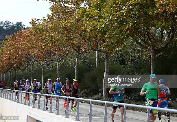 Participants compete in the run leg of the race during Ironman Barcelona on October 04 2015 in Barcelona Spain