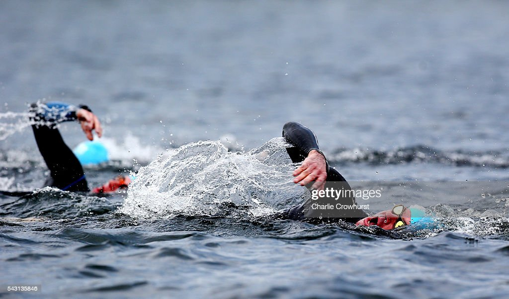 Participants compete in the swim leg during the Ironman 70.3 UK at Exmoor National Park on June 26, 2016 in Somerset, England.