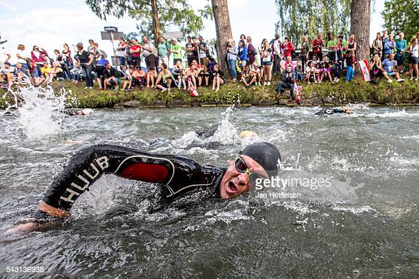 Participants compete in the swim leg during the Ironman Austria on June 26 2016 in Klagenfurt Austria
