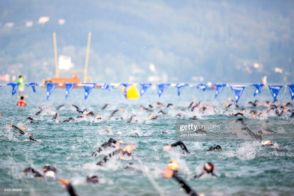 Participants compete in the swim leg during the Ironman Austria on June 26, 2016 in Klagenfurt, Austria.