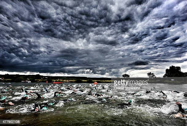 Participants compete in the swim leg of the race during Ironman 703 Luxembourg on June 20 2015 in Remich Luxembourg