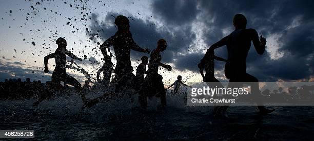 Participants compete in the swim leg of the race during Ironman Mallorca on September 27 2014 in Palma de Mallorca Spain