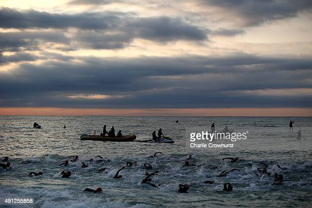 Participants compete in the swim leg of the race during Ironman Barcelona on October 04 2015 in Barcelona Spain