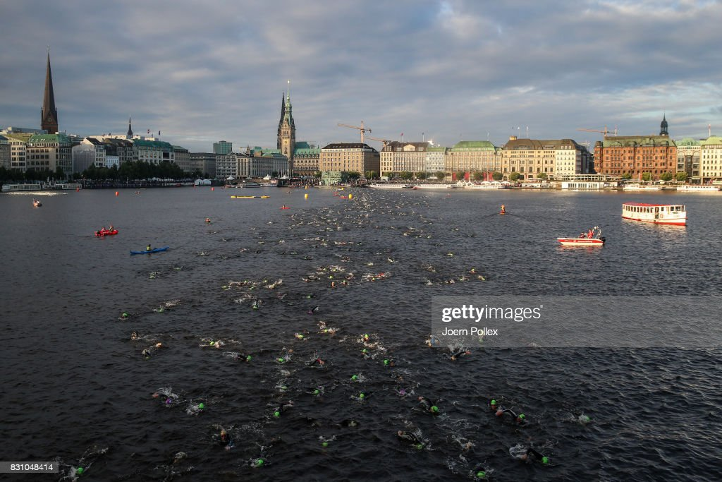 Participants compete in the swim leg of the race during IRONMAN Hamburg on August 13, 2017 in Hamburg, Germany.
