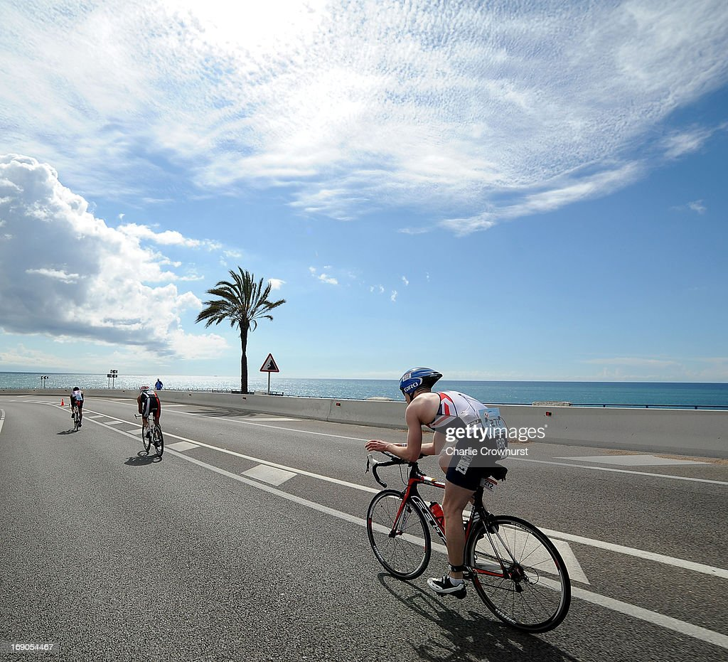 Participants cycle along the coast during the Challenge Family Triathlon Barcelona on May 19, 2013 in Barcelona, Spain.