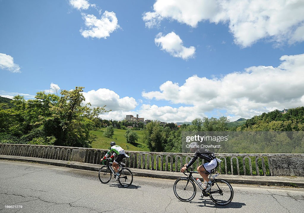 Participants cycle over a bridge during the Challenge Family Triathlon Rimini on May 26, 2013 in Rimini, Italy.