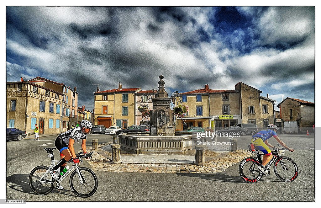 Participants cycle through a French town during the Challenge Triathlon Vichy on September 01, 2013 in Vichy, France.