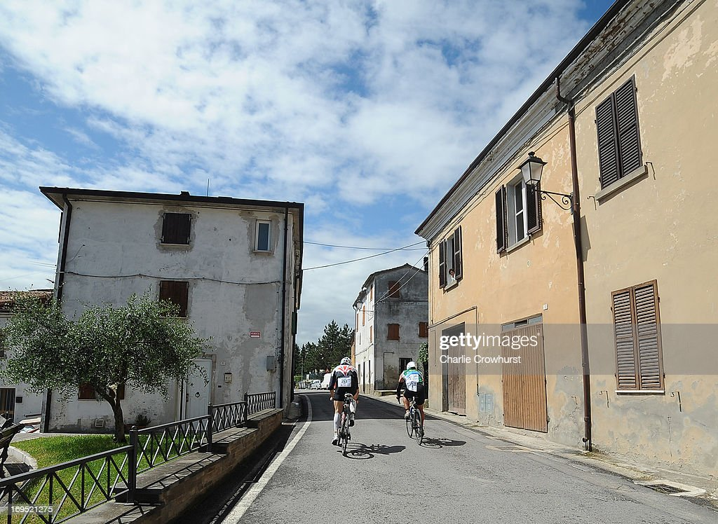 Participants cycle through a small town during the Challenge Family Triathlon Rimini on May 26, 2013 in Rimini, Italy.