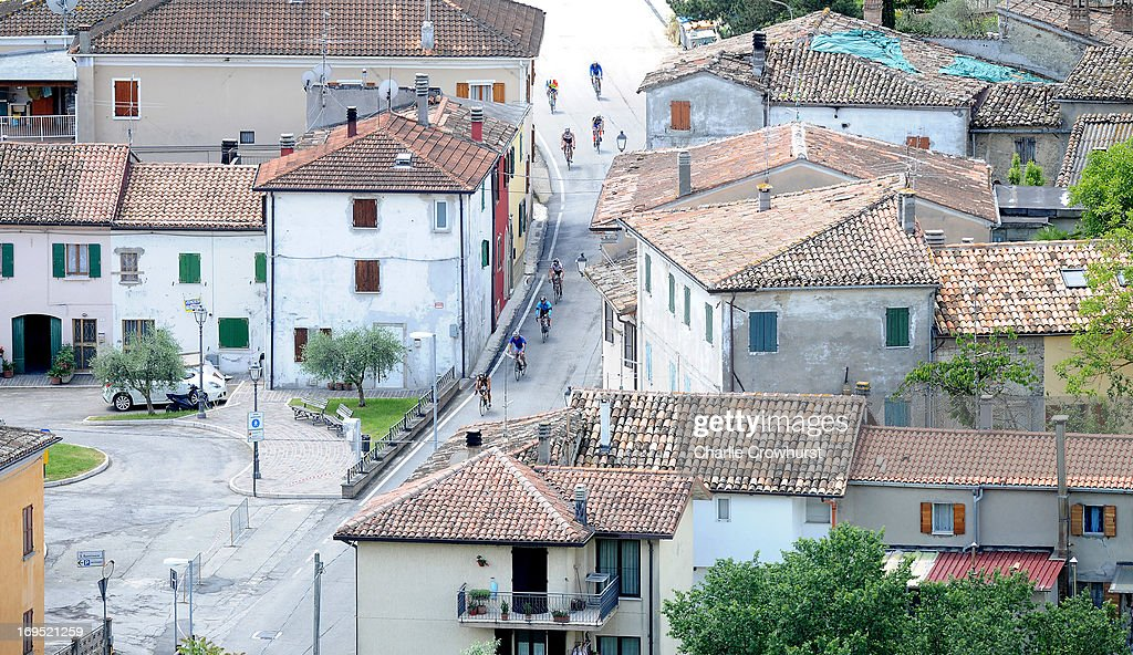 Participants cycle through a town during the Challenge Family Triathlon Rimini on May 26, 2013 in Rimini, Italy.