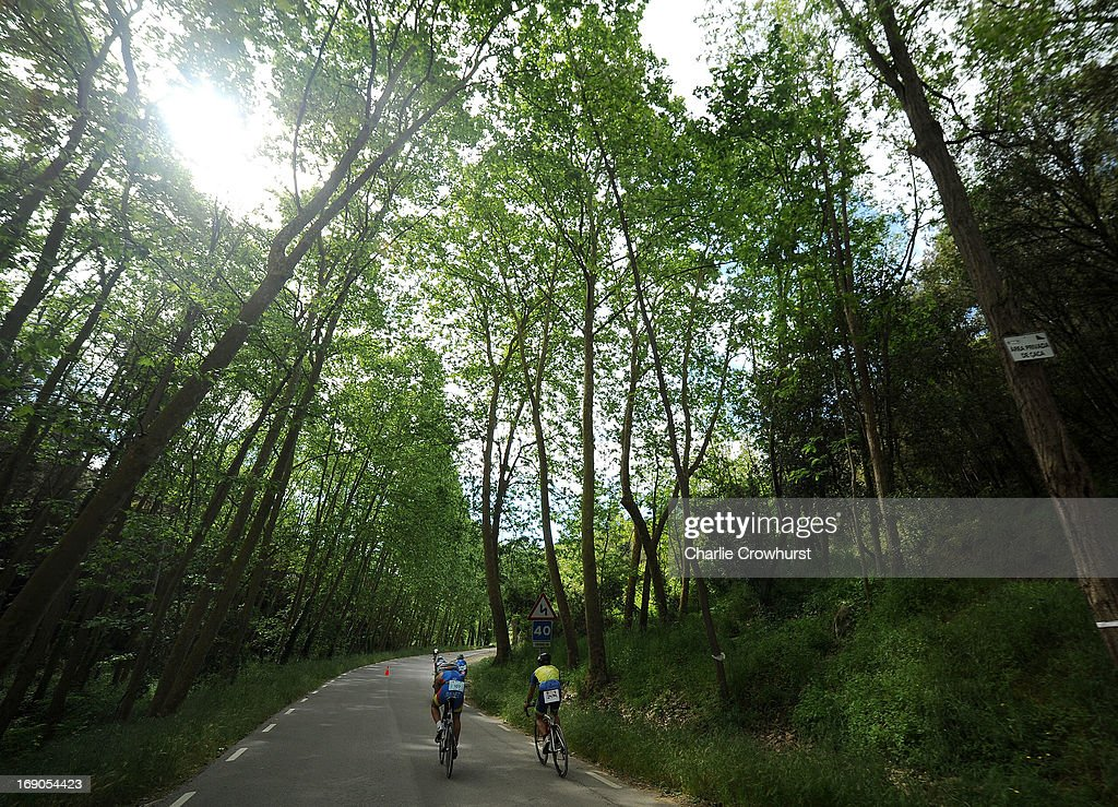 Participants cycle through the woods during the Challenge Family Triathlon Barcelona on May 19, 2013 in Barcelona, Spain.
