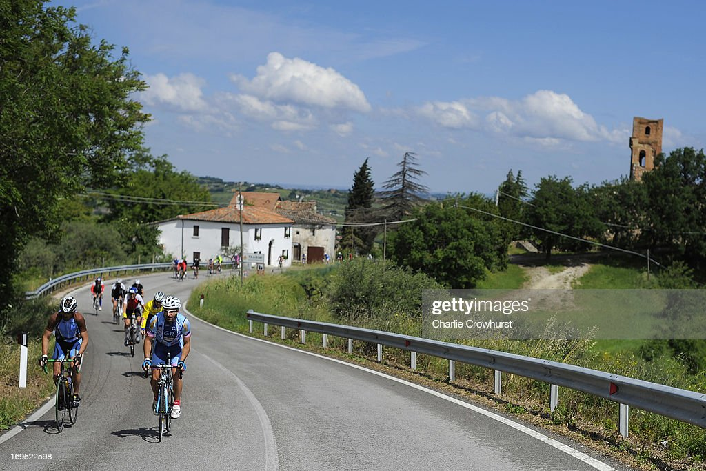 Participants cycle up hill during the Challenge Family Triathlon Rimini on May 26, 2013 in Rimini, Italy.