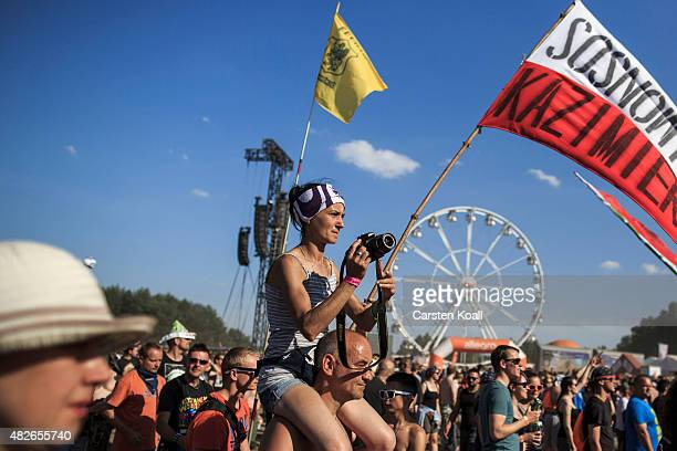 Participants dance at the 2015 Woodstock Festival Poland on August 1 2015 in Kostrzyn Poland The Polish Woodstock music festival also called...