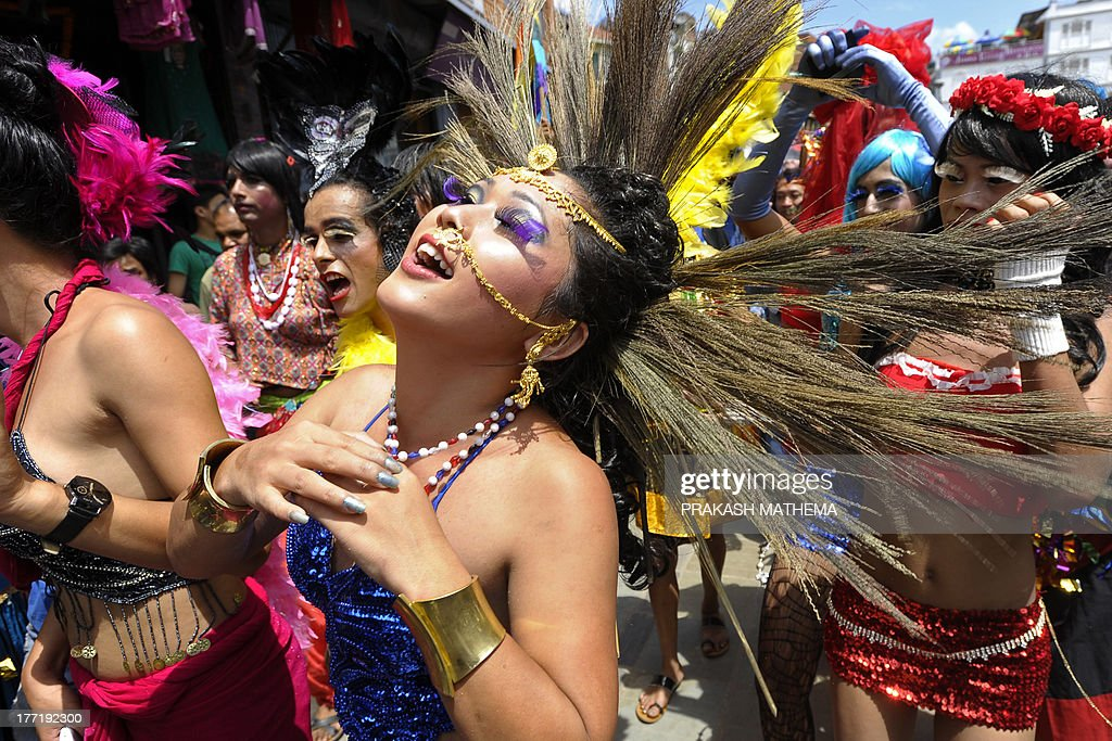 Participants dance during Nepal's 4th International Gay Pride parade in Kathmandu on August 22, 2013. Scores of gays, lesbians, transvestites and transsexuals from across the country took part in the rally to spread their campaign for sexual rights in the country. AFP PHOTO/Prakash MATHEMA