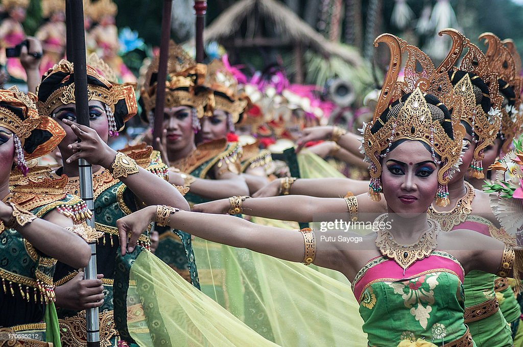 Participants dance during the Bali International Arts Festival on June 15, 2013 in Denpasar, Bali, Indonesia. The annual month-long festival runs from June 15 to July 13, 2013 and features 340 local and international art communities with thousands of performers.
