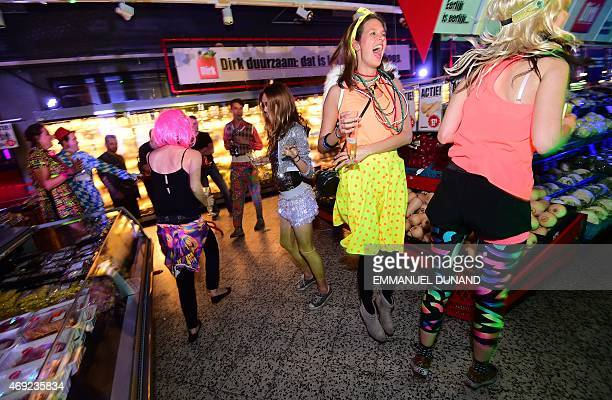 Participants dance in a disco groceries party a concept which turns a supermarket into a night club after its closing time in Amsterdam on April 10...