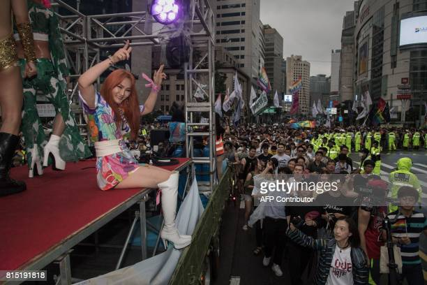 Participants dance on a float during a gay rights march in Seoul on July 15 2017 Thousands of people celebrated gay rights with song dance and a...