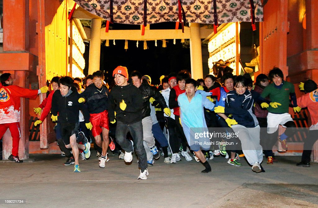 Participants dashes as the gate opens during 'Fuku otoko erabi' or lucky man race as a part of the 'Toka Ebisu' festival at Nishinomiya Shrine on January 10, 2013 in Nishinomiya, Hyogo, Japan. The annual race, start at 6:00am on Janaury 10, competed by running 230 meters from the gate to the main hall.
