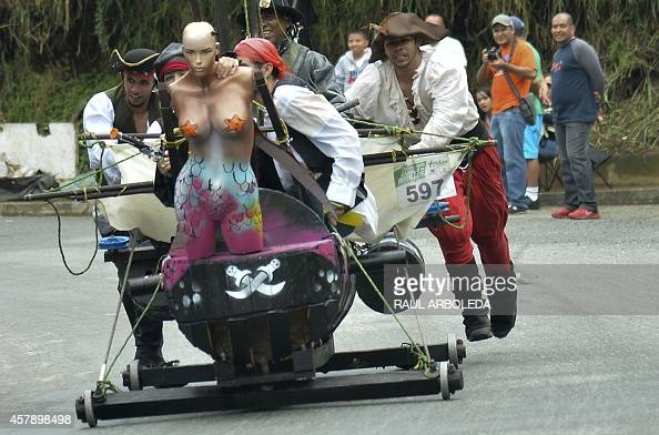 Participants descend a hill in a homemade cart during the XXV Car Festival in Medellin Antioquia department Colombia on October 26 2014 AFP...