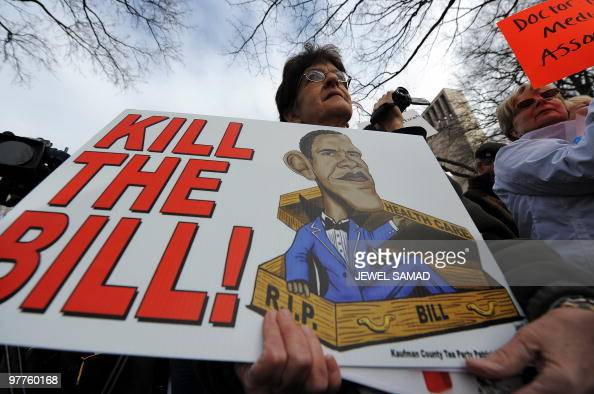 Participants display placards during a demonstration organized by the American Grass Roots Coalition and the Tea Party Express in Washington DC on...